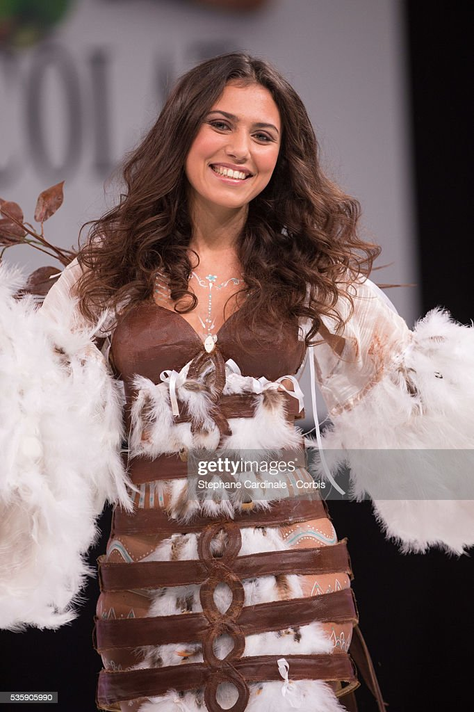 Singer Judith Hassine walks the runway and wears 'La Magicienne Itzia' a chocolate dress made by designer Valerie Pache and chocolate maker Stephane Bonnat, during the Fashion Chocolate Show at Salon du Chocolat at Porte de Versailles, in Paris.