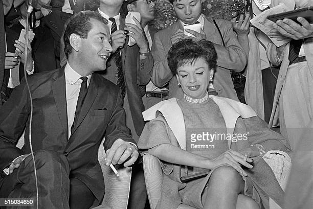 Singer Judy Garland and her business manager Mark Herron who have been making news with the claim that they are married seem delighted to meet the...