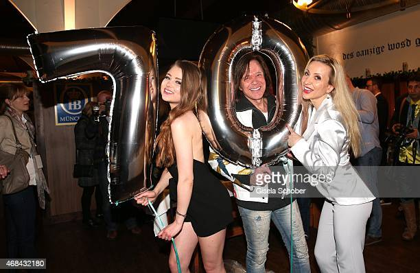 Singer Juergen Drews with his daughter and his wife Ramona Drews during Juergen Drews' 70th Birthday Party at Hofbraeuhaus on April 02 2015 in Berlin...