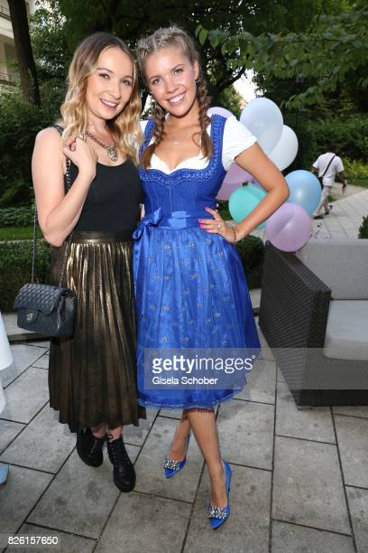 Singer Julia Kautz and Victoria Swarovski during the presentation of Victoria Swarovski's dirndl collection 'Candy Collection' by Krueger at 'The...