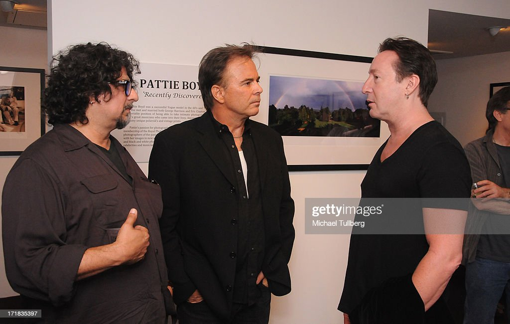 Singer Julian Lennon (R) chats with friends at an exhibition of photographer Pattie Boyd's photographs entitled 'Pattie Boyd: Newly Discovered' at Morrison Hotel Gallery on June 28, 2013 in West Hollywood, California.