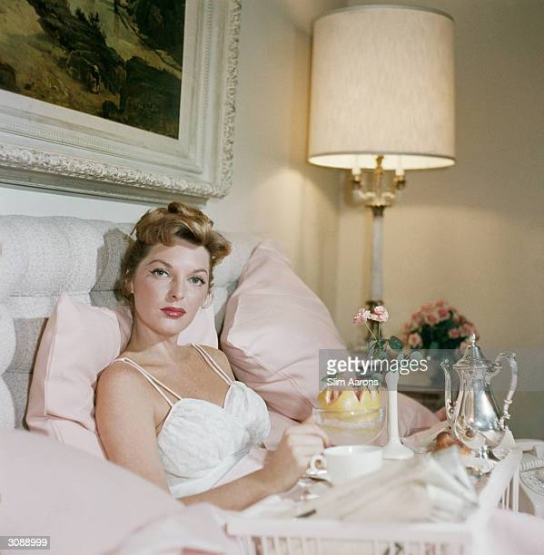 Singer Julie London enjoying breakfast in bed at the Beverly Hills Hotel A Wonderful Time Slim Aarons