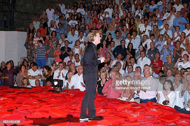 Singer Juliette Greco and all the Public watching Humorist Alex Lutz acknowledges the applause of the audience whyle the traditional throw of...