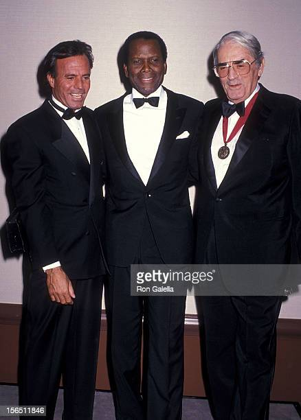 Singer Julio Iglesias actor Sidney Poitier and actor Gregory Peck attend the American Friends of the Hebrew University's 19th Annual Scopus Award...