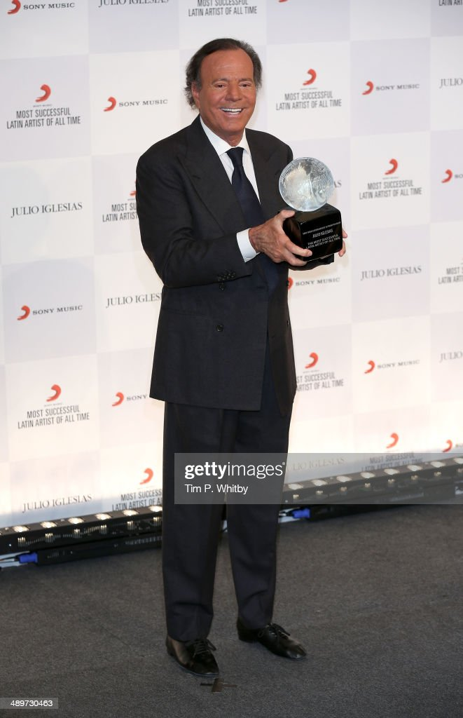 Singer <a gi-track='captionPersonalityLinkClicked' href=/galleries/search?phrase=Julio+Iglesias&family=editorial&specificpeople=218023 ng-click='$event.stopPropagation()'>Julio Iglesias</a> attends a photocall where he is honoured by Sony Music as the most successful Latin artist of all time at The Dorchester on May 12, 2014 in London, England.