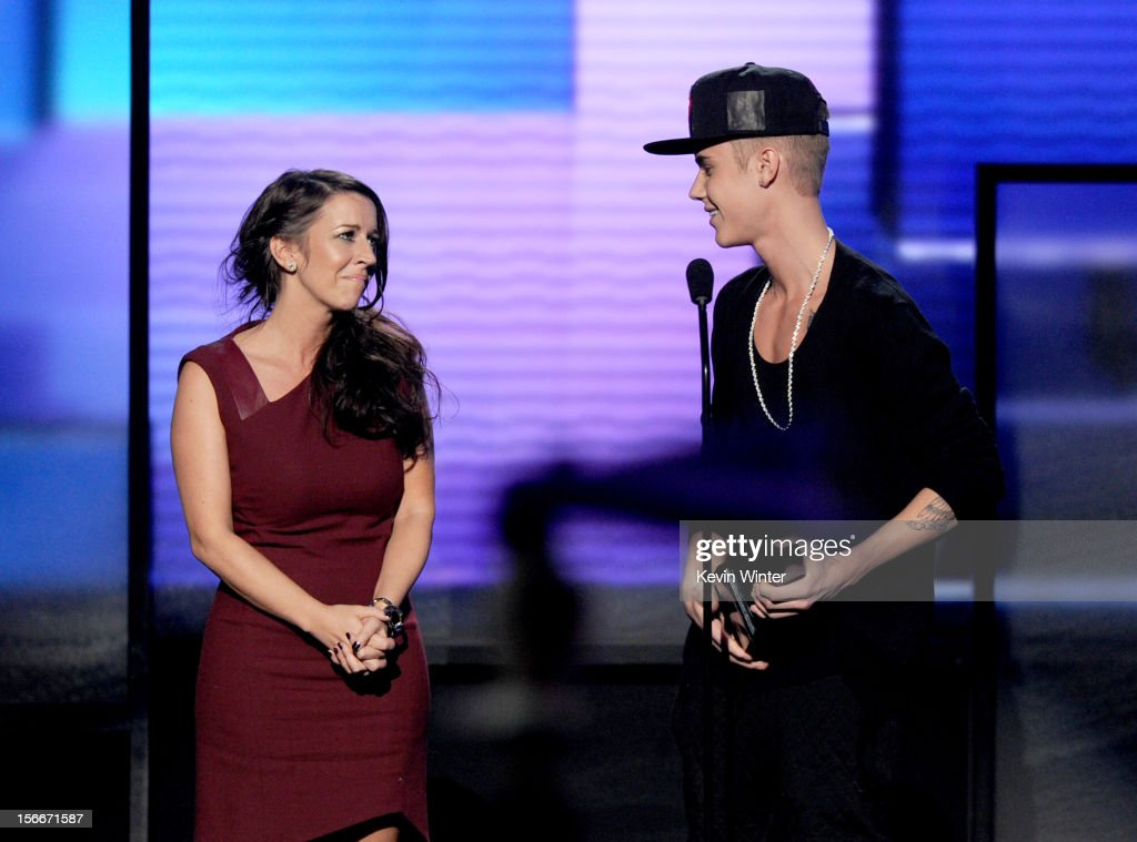 Singer Justin Bieber accepts the award for Artist of the Year with Pattie Malette onstage during the 40th American Music Awards held at Nokia Theatre...