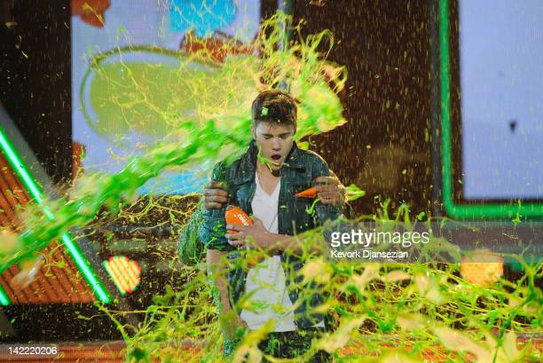 Singer Justin Bieber accepts the Favorite Singer award onstage at Nickelodeon's 25th Annual Kids' Choice Awards held at Galen Center on March 31 2012...