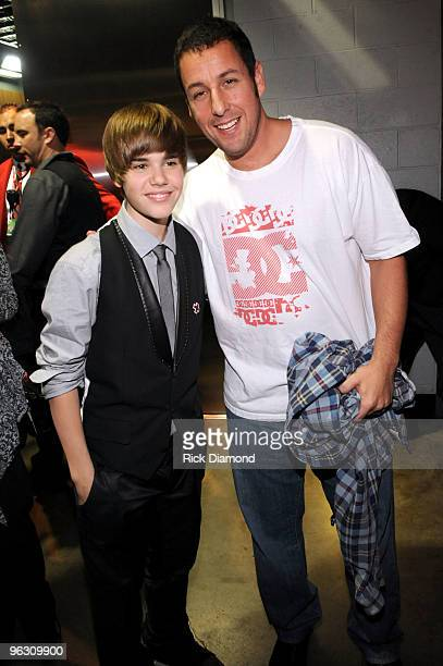 Singer Justin Bieber and actor Adam Sandler backstage at the 52nd Annual GRAMMY Awards held at Staples Center on January 31 2010 in Los Angeles...