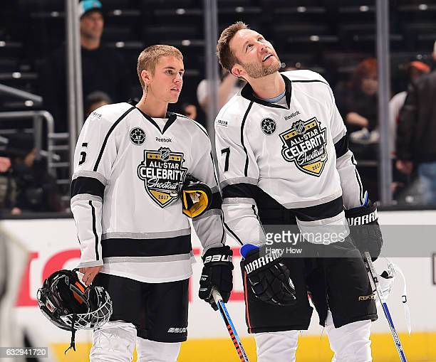 Singer Justin Bieber and actor Michael Rosenbaum look on during the 2017 NHL AllStar Celebrity Shootout as part of the 2017 NHL AllStar Weekend at...