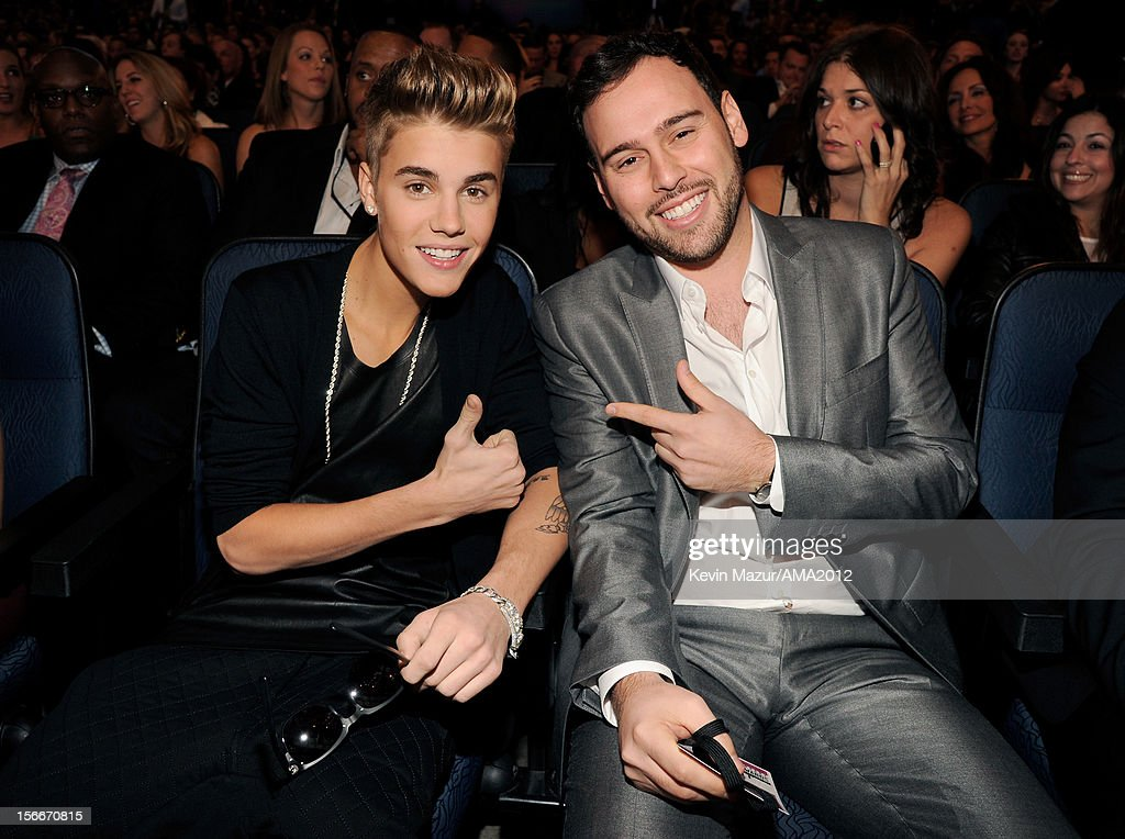 Singer <a gi-track='captionPersonalityLinkClicked' href=/galleries/search?phrase=Justin+Bieber&family=editorial&specificpeople=5780923 ng-click='$event.stopPropagation()'>Justin Bieber</a> (L) and manager Scoot Braun pose in the audience at the 40th American Music Awards held at Nokia Theatre L.A. Live on November 18, 2012 in Los Angeles, California.
