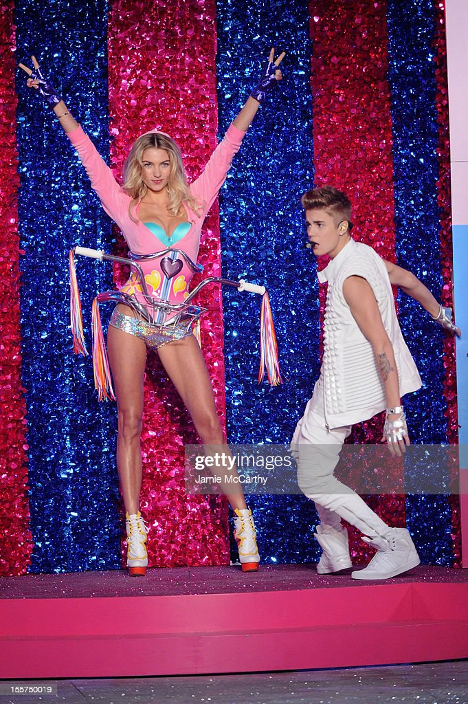 Singer <a gi-track='captionPersonalityLinkClicked' href=/galleries/search?phrase=Justin+Bieber&family=editorial&specificpeople=5780923 ng-click='$event.stopPropagation()'>Justin Bieber</a> and model <a gi-track='captionPersonalityLinkClicked' href=/galleries/search?phrase=Jessica+Hart&family=editorial&specificpeople=4436555 ng-click='$event.stopPropagation()'>Jessica Hart</a> onstage during the 2012 Victoria's Secret Fashion Show at the Lexington Avenue Armory on November 7, 2012 in New York City.