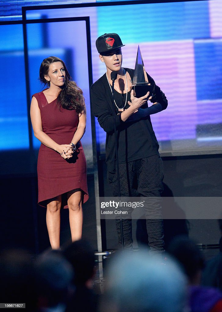 Singer Justin Bieber (R) and mother Patricia speak onstage during the 40th Anniversary American Music Awards held at Nokia Theatre L.A. Live on November 18, 2012 in Los Angeles, California.