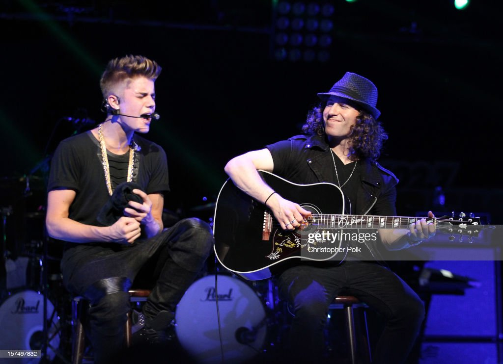 Singer Justin Bieber and musician Dan Kanter perform onstage during KIIS FM's 2012 Jingle Ball at Nokia Theatre L.A. Live on December 3, 2012 in Los Angeles, California.