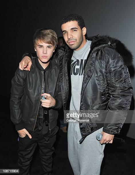 Singer Justin Bieber and singer Drake attend the premiere for 'Never Say Never' at the AMC Yonge Dundas 24 theater on February 1 2011 in Toronto...
