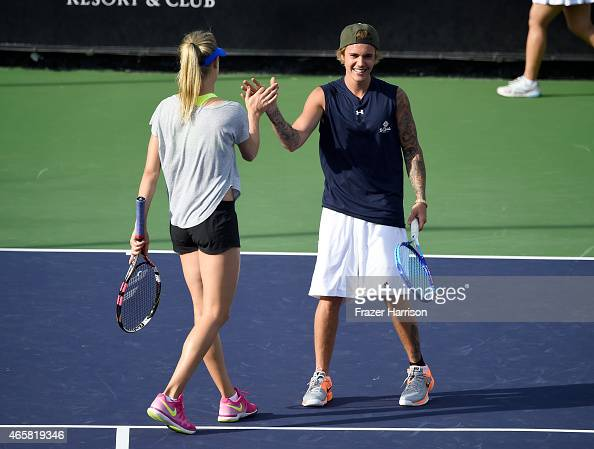 Singer Justin Bieber and tennis player Eugenie 'Genie' Bouchard attend the 11th Annual Desert Smash Hosted By Will Ferrell Benefiting Cancer For...