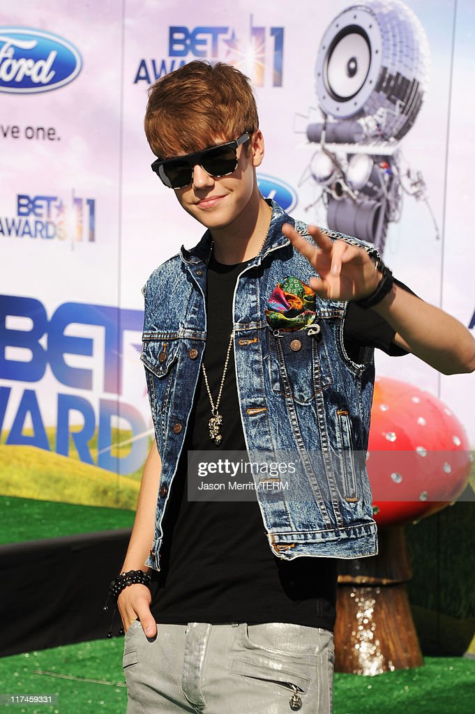 Singer <a gi-track='captionPersonalityLinkClicked' href=/galleries/search?phrase=Justin+Bieber&family=editorial&specificpeople=5780923 ng-click='$event.stopPropagation()'>Justin Bieber</a> arrives at the BET Awards '11 held at the Shrine Auditorium on June 26, 2011 in Los Angeles, California.