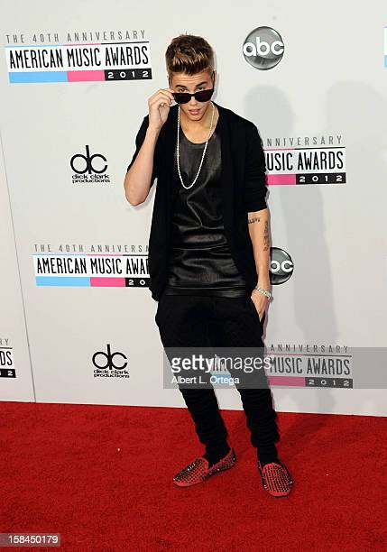 Singer Justin Bieber arrives for the 40th Anniversary American Music Awards Arrivals held at Nokia Theater LA Live on November 18 2012 in Los Angeles...
