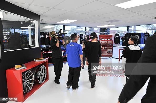 Singer Justin Bieber gets a tour of the facilities by founder of West Coast Customs Ryan Friedlinghaus during the Grand Opening of West Coast Customs...