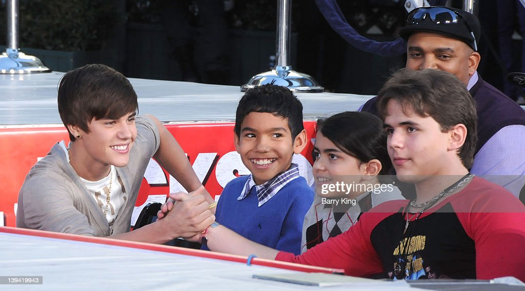 Singer Justin Bieber, guest, Blanket Jackson and Prince Michael Jackson attend the Michael Jackson 'Immortalized' hand and footprint ceremony held at Grauman's Chinese Theatre on January 26, 2012 in Hollywood, California.