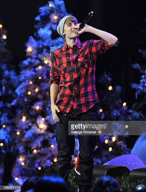 Singer Justin Bieber is home for the Holidays and performs in concert for a special acoustic Christmas show at Massey Hall on December 21 2011 in...