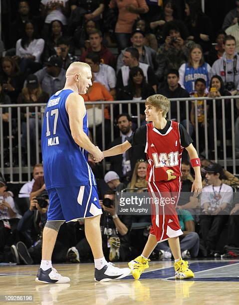Singer Justin Bieber of the West high fives NBA Legend Chris Mullin of the East during the BBVA 2011 NBA AllStar Celebrity Game on center court at...