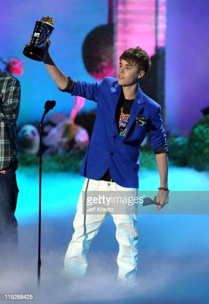 Singer Justin Bieber onstage during the 2011 MTV Movie Awards at Universal Studios' Gibson Amphitheatre on June 5 2011 in Universal City California