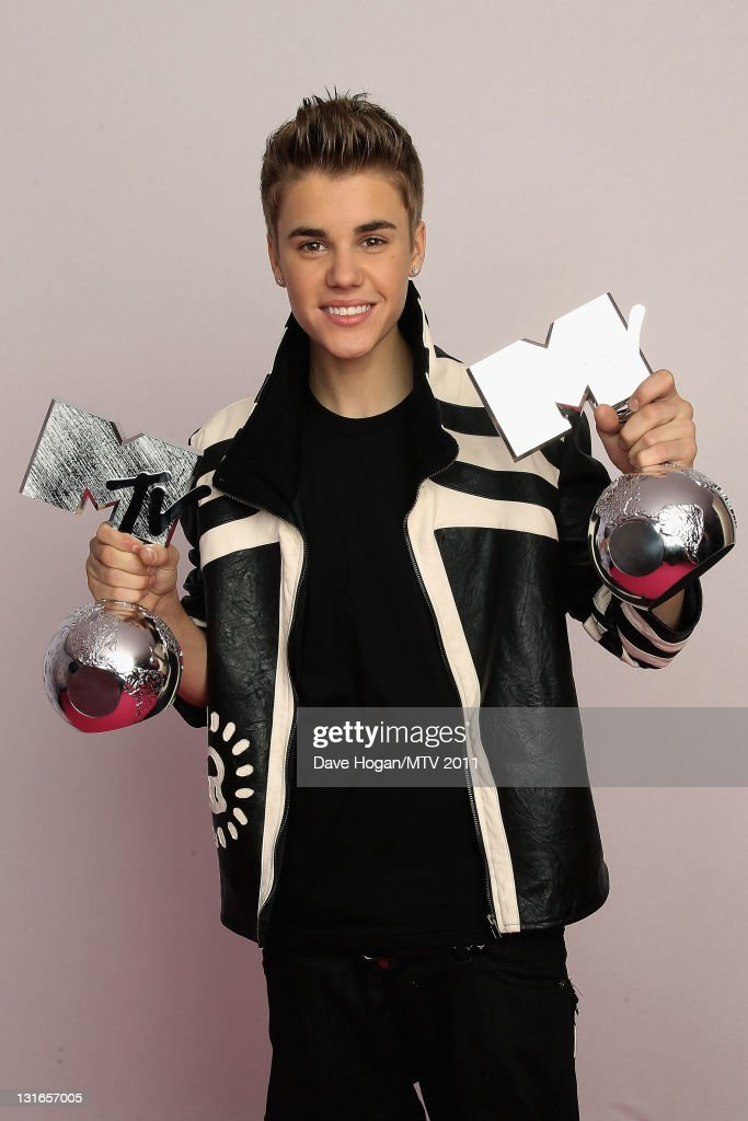Singer <a gi-track='captionPersonalityLinkClicked' href=/galleries/search?phrase=Justin+Bieber&family=editorial&specificpeople=5780923 ng-click='$event.stopPropagation()'>Justin Bieber</a> poses backstage with his awards for Best Male and Best Pop Act during the MTV Europe Music Awards 2011 at Odyssey Arena on November 6, 2011 in Belfast, Northern Ireland.