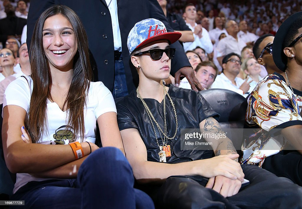 Singer Justin Bieber sits courtside as he watches the Miami Heat host the Indiana Pacers during Game Seven of the Eastern Conference Finals of the 2013 NBA Playoffs at AmericanAirlines Arena on June 3, 2013 in Miami, Florida.
