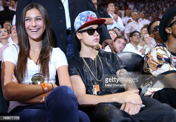 Singer Justin Bieber sits courtside as he watches the Miami Heat host the Indiana Pacers during Game Seven of the Eastern Conference Finals of the...