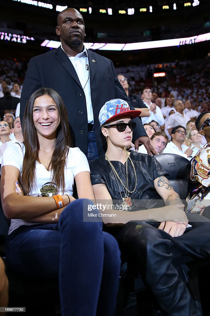 Singer <a gi-track='captionPersonalityLinkClicked' href=/galleries/search?phrase=Justin+Bieber&family=editorial&specificpeople=5780923 ng-click='$event.stopPropagation()'>Justin Bieber</a> sits courtside as he watches the Miami Heat host the Indiana Pacers during Game Seven of the Eastern Conference Finals of the 2013 NBA Playoffs at AmericanAirlines Arena on June 3, 2013 in Miami, Florida.