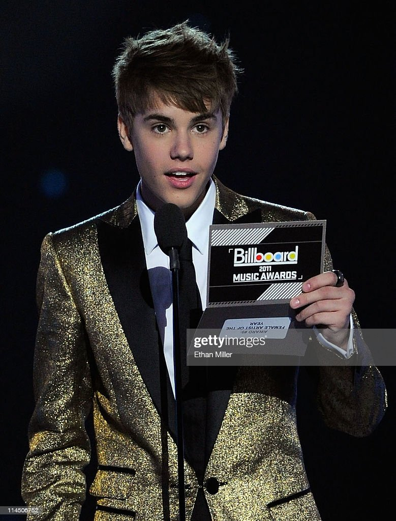 Singer <a gi-track='captionPersonalityLinkClicked' href=/galleries/search?phrase=Justin+Bieber&family=editorial&specificpeople=5780923 ng-click='$event.stopPropagation()'>Justin Bieber</a> speaks onstage during the 2011 Billboard Music Awards at the MGM Grand Garden Arena May 22, 2011 in Las Vegas, Nevada.