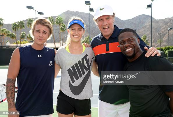 Singer Justin Bieber tennis player Eugenie 'Genie' Bouchard comedian Will Ferrell and comedian Kevin Hart celebrate with Moet Chandon at the 11th...