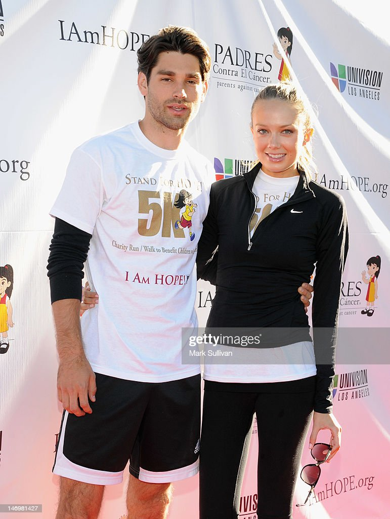 Singer <a gi-track='captionPersonalityLinkClicked' href=/galleries/search?phrase=Justin+Gaston&family=editorial&specificpeople=5540524 ng-click='$event.stopPropagation()'>Justin Gaston</a> and actress <a gi-track='captionPersonalityLinkClicked' href=/galleries/search?phrase=Melissa+Ordway&family=editorial&specificpeople=5132902 ng-click='$event.stopPropagation()'>Melissa Ordway</a> attend PADRES Contra El Cancer's 'Stand For HOPE!' 5K Run/Walk at Rose Bowl on June 24, 2012 in Pasadena, California.