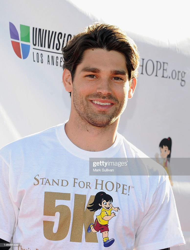 Singer <a gi-track='captionPersonalityLinkClicked' href=/galleries/search?phrase=Justin+Gaston&family=editorial&specificpeople=5540524 ng-click='$event.stopPropagation()'>Justin Gaston</a> attends PADRES Contra El Cancer's 'Stand For HOPE!' 5K Run/Walk at Rose Bowl on June 24, 2012 in Pasadena, California.