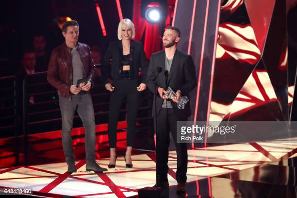 Singer Justin Timberlake accepts the Song of the Year award for 'Can't Stop The Feeling' from actor Jeremy Renner onstage at the 2017 iHeartRadio...