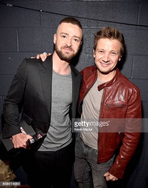 Singer Justin Timberlake and actor Jeremy Renner pose with the Song of the Year award for 'Can't Stop The Feeling' at the 2017 iHeartRadio Music...
