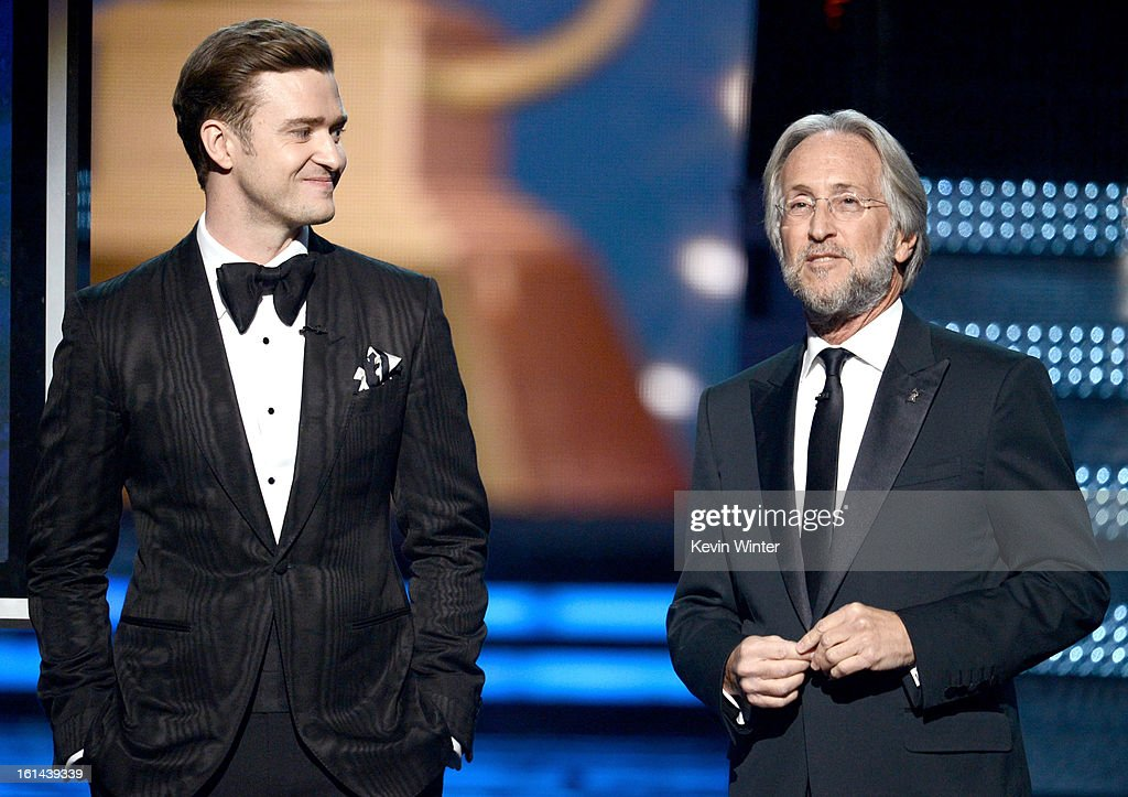 Singer Justin Timberlake (L) and President/CEO of The Recording Academy Neil Portnow speak onstage during the 55th Annual GRAMMY Awards at STAPLES Center on February 10, 2013 in Los Angeles, California.
