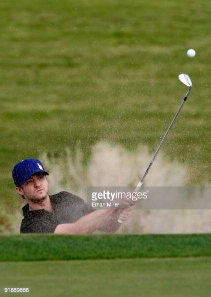 Singer Justin Timberlake hits out of a bunker on the 3rd hole during the Justin Timberlake Shriners Hospitals for Children Open Championship ProAm at...