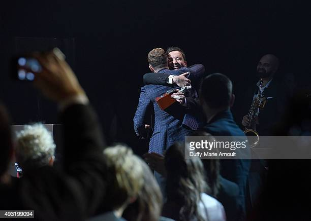 Singer Justin Timberlake is presented with induction award by comedian Jimmy Fallon during the Memphis Music Hall of Fame Induction Ceremony at the...