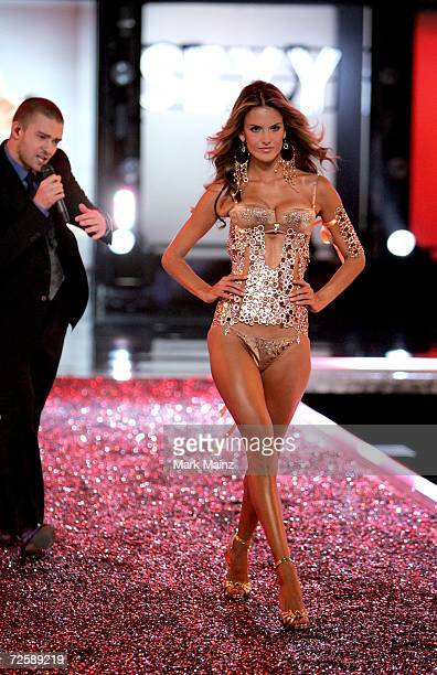 Singer Justin Timberlake performs as model Alessandra Ambrosio walks the runway during the Victoria's Secret Fashion Show held at the Kodak Theatre...