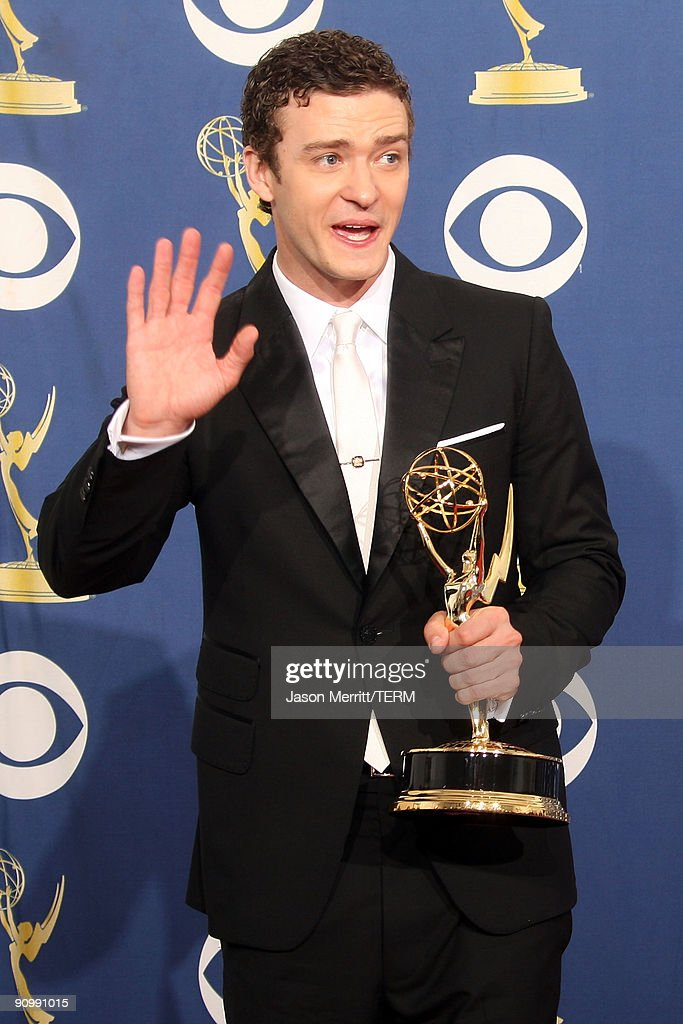 Singer <a gi-track='captionPersonalityLinkClicked' href=/galleries/search?phrase=Justin+Timberlake&family=editorial&specificpeople=157482 ng-click='$event.stopPropagation()'>Justin Timberlake</a> poses in the press room with his Emmy for Oustanding Guest Actor in a Comedy Series for 'Saturday Night Live' at the 61st Primetime Emmy Awards held at the Nokia Theatre on September 20, 2009 in Los Angeles, California.