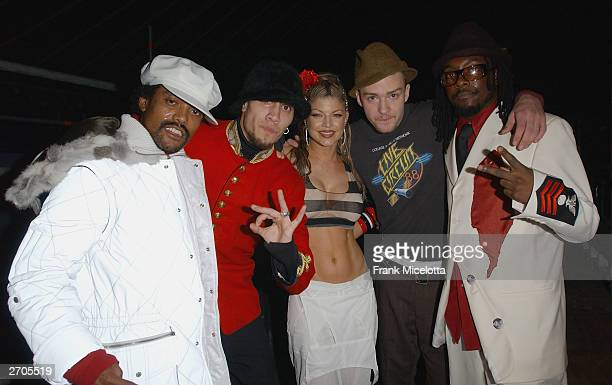 Singer Justin Timberlake poses with Black Eyed Peas backstage during the 2003 MTV Europe Music Awards at Ocean Terminal on November 6 2003 in...