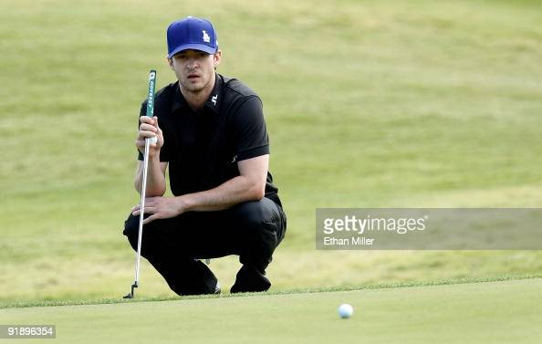 Singer Justin Timberlake watches another player's ball roll by on the 8th hole green during the Justin Timberlake Shriners Hospitals for Children...