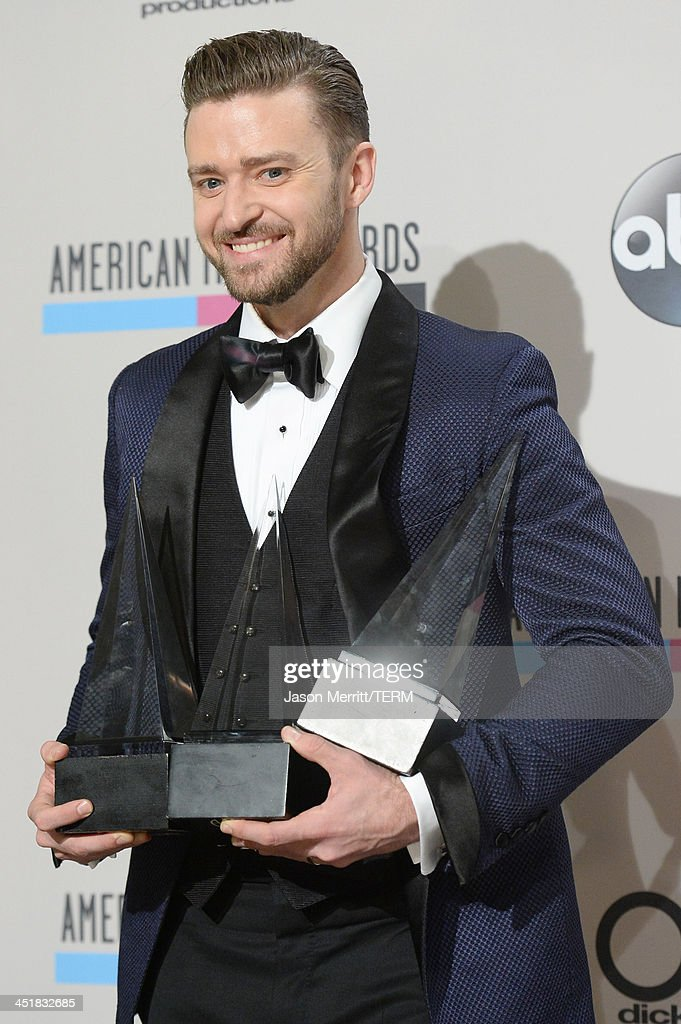 Singer <a gi-track='captionPersonalityLinkClicked' href=/galleries/search?phrase=Justin+Timberlake&family=editorial&specificpeople=157482 ng-click='$event.stopPropagation()'>Justin Timberlake</a>, winner of the Favorite Soul/R&B Male Artist, Favorite Pop/Rock Male Artist, and Favorite Soul/R&B Album awards, poses in the press room during the 2013 American Music Awards at Nokia Theatre L.A. Live on November 24, 2013 in Los Angeles, California.