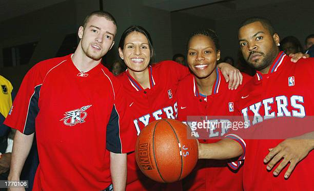 Singer Justin Timberlake WNBA players Ticha Penichiero Nikki McCray and actor Ice Cube pose prior to the Celebrity Game at the NBA Jam Session at the...