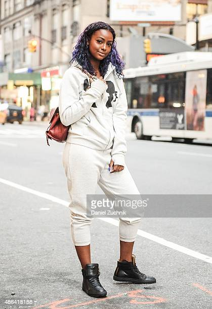 Singer Justine Skye is seen wearing a Boy Meets Girl sweatshirt and sweatpants with Koio Collective shoes and a Chanel bag during a fitting for the...