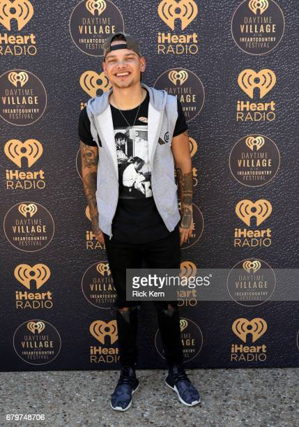 Singer Kane Brown poses during the 2017 Daytime Village at the iHeartCountry Festival A Music Experience by ATT at The Frank Erwin Center on May 6...