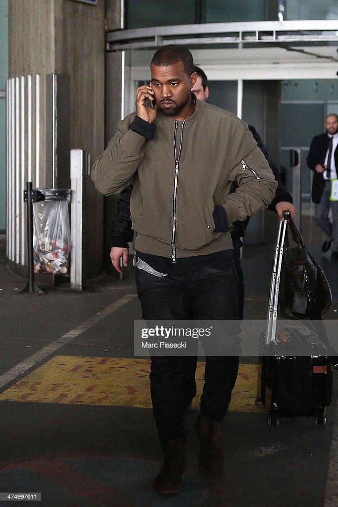 Singer Kanye West arrives at Charles-de-Gaulle airport on February 26, 2014 in Paris, France.