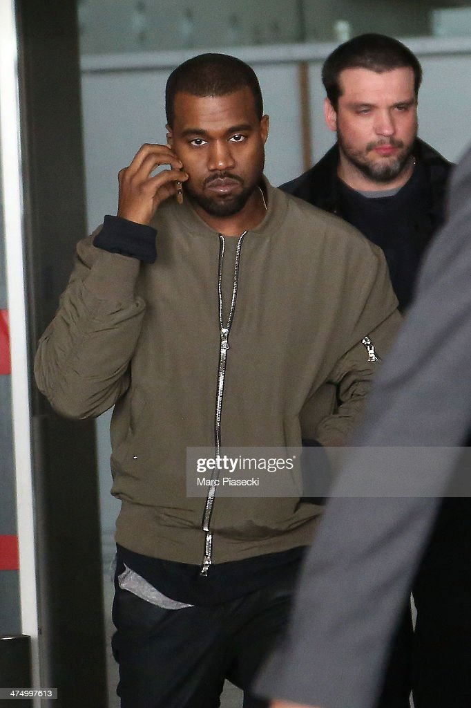Singer Kanye West arrives at Charles-de-Gaulle airport on February 26, 2014 in Paris, France.