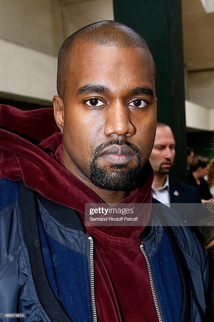 Singer Kanye West attends the Celine show as part of the Paris Fashion Week Womenswear Fall/Winter 2015/2016 on March 8 2015 in Paris France